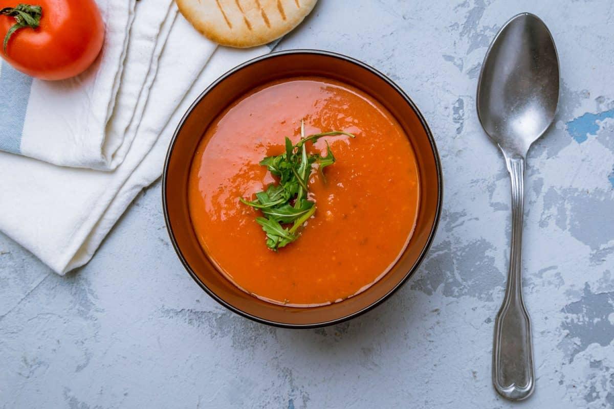 A delicious soup cream tomato on a brown bowl