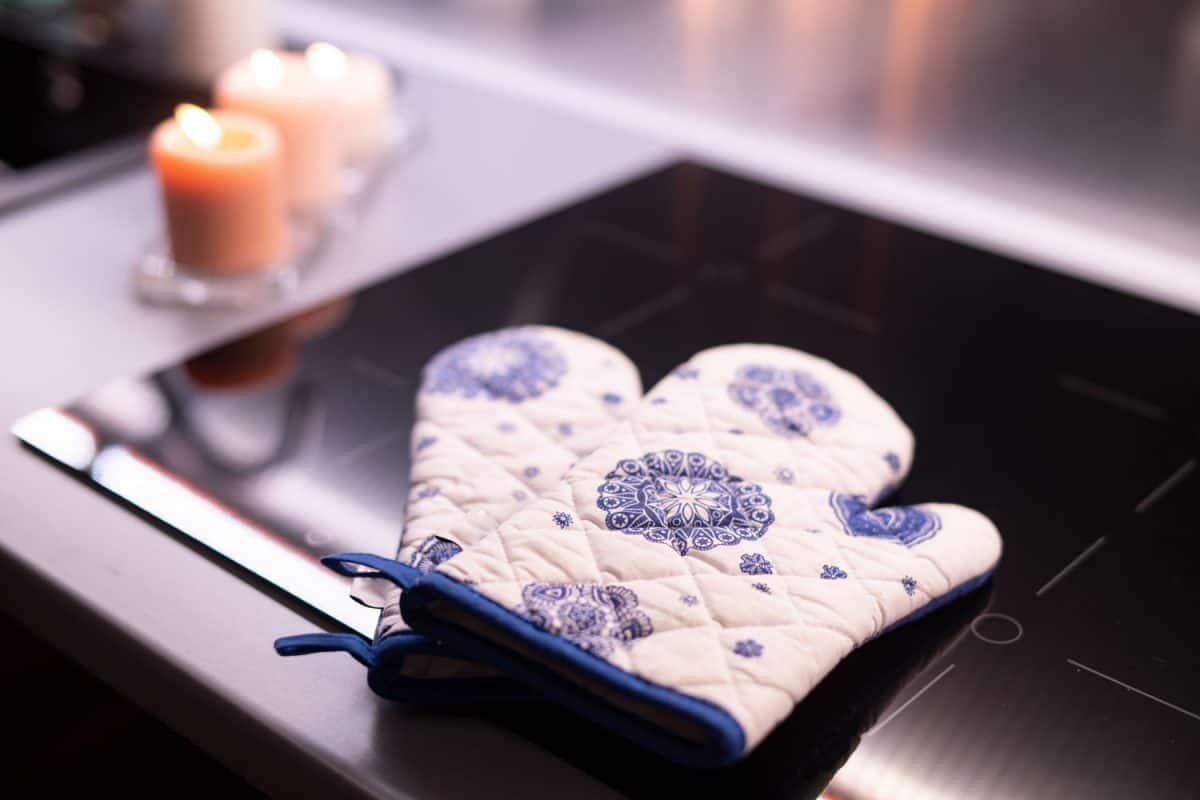 A floral colored oven mitts placed on top of an infrared cooker