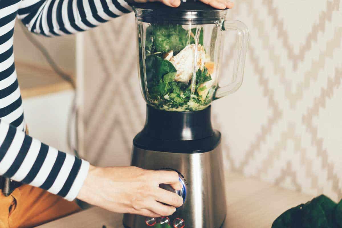 A large blender bowl whips the ingredients for a smoothie, Is A Blender Dishwasher Safe? [Including Top Brands]