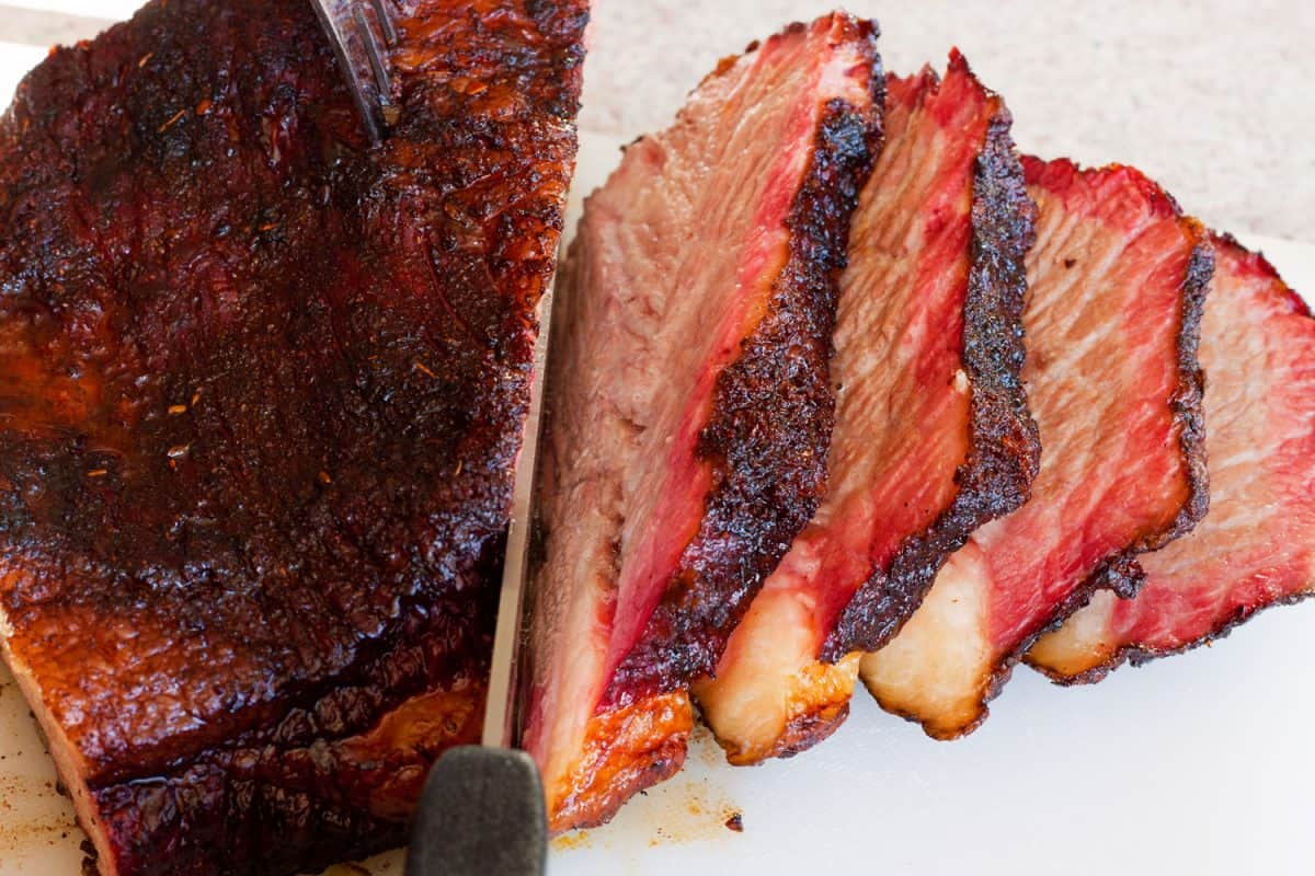 A medium rare cooked beef brisket perfectly sliced into pieces, Is A Bread Knife Good For Cutting Brisket?