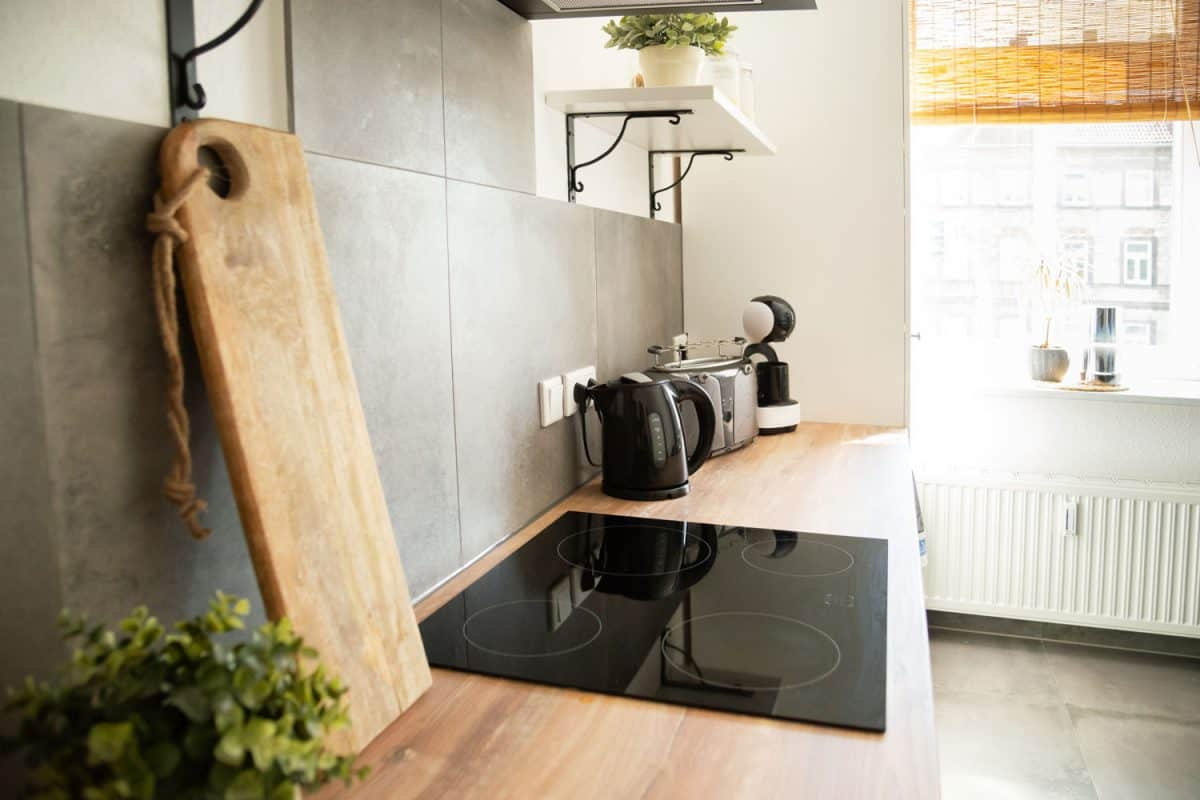 A minimalist and modern inspired kitchen with a black induction cooktop, Can Le Creuset Be Used On Induction Cooktops?
