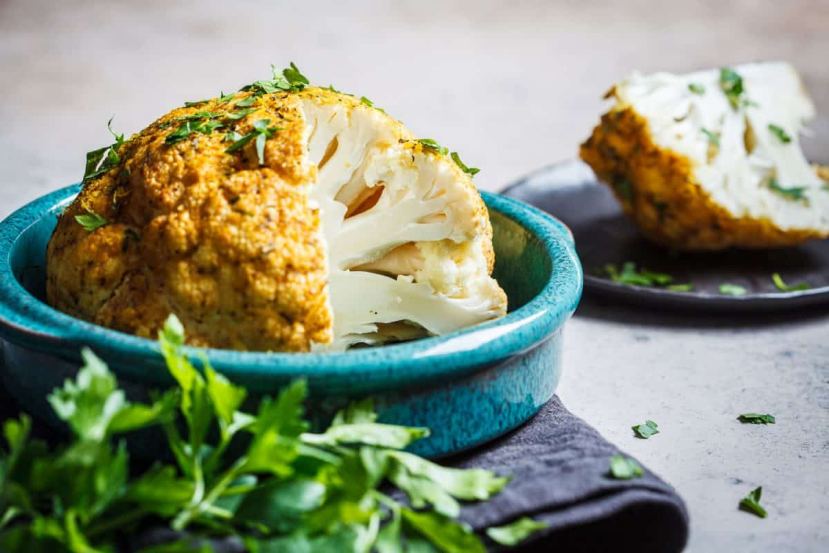 A whole baked cauliflower with spices and herbs