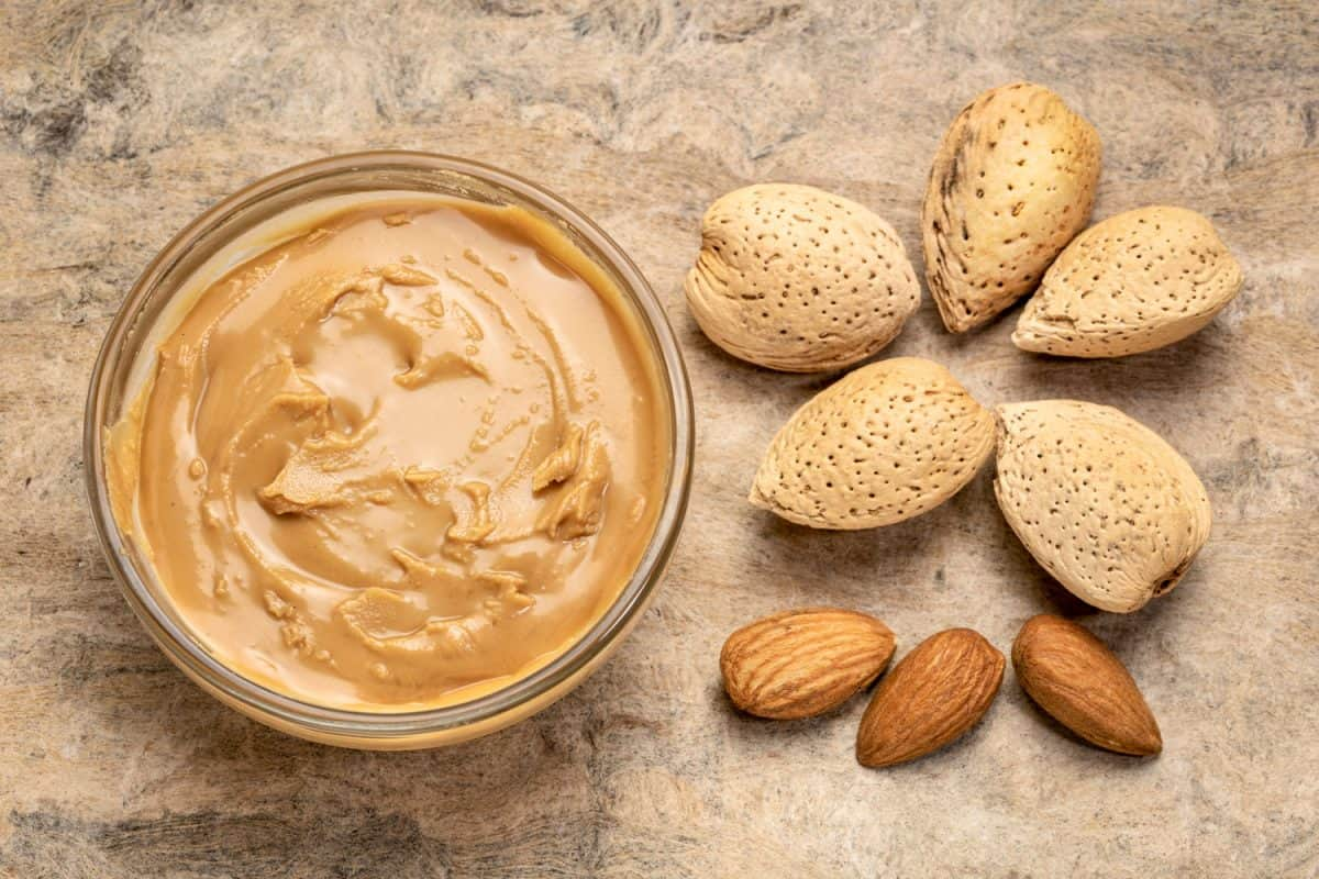 Almond butter and almond nuts on the side
