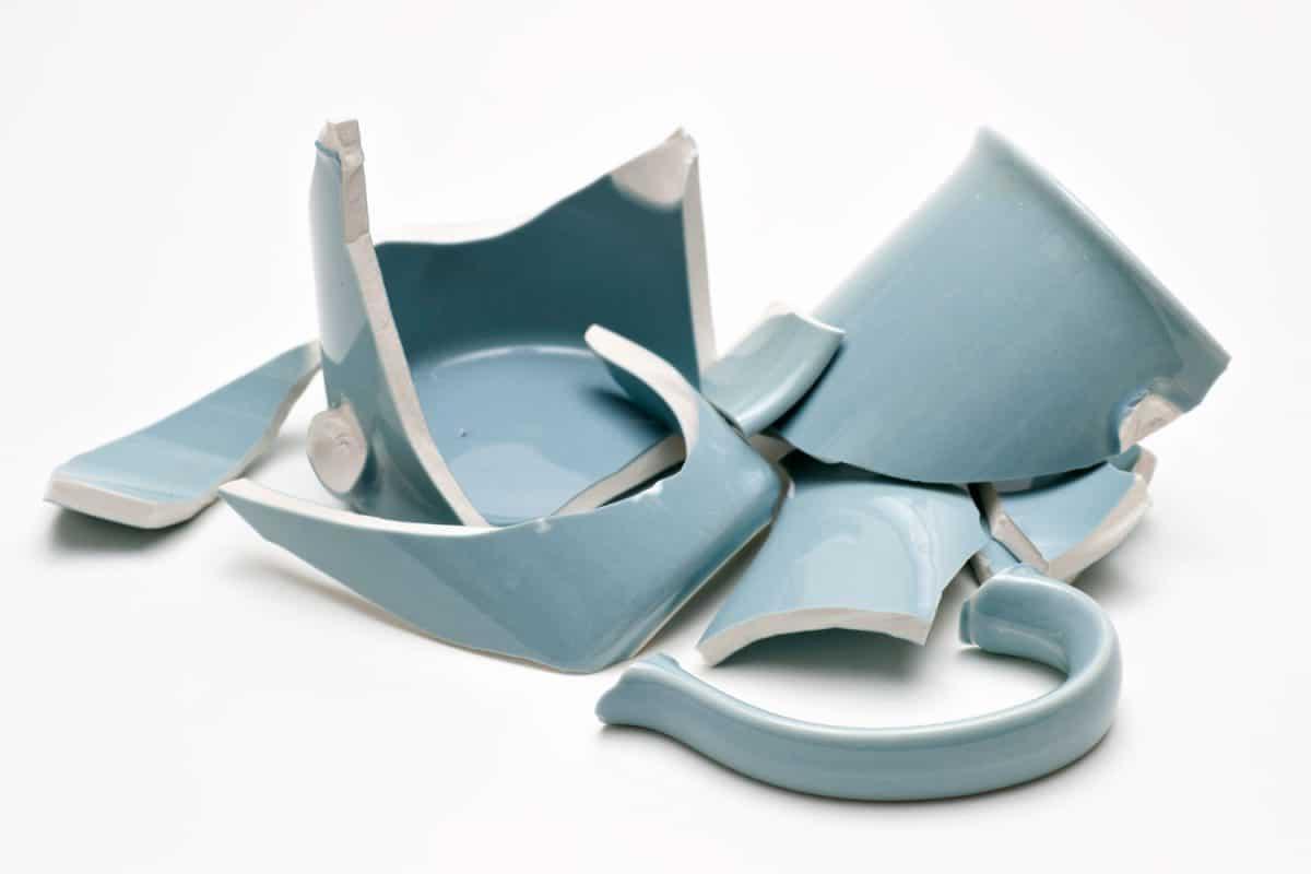 Broken blue mug on a white background