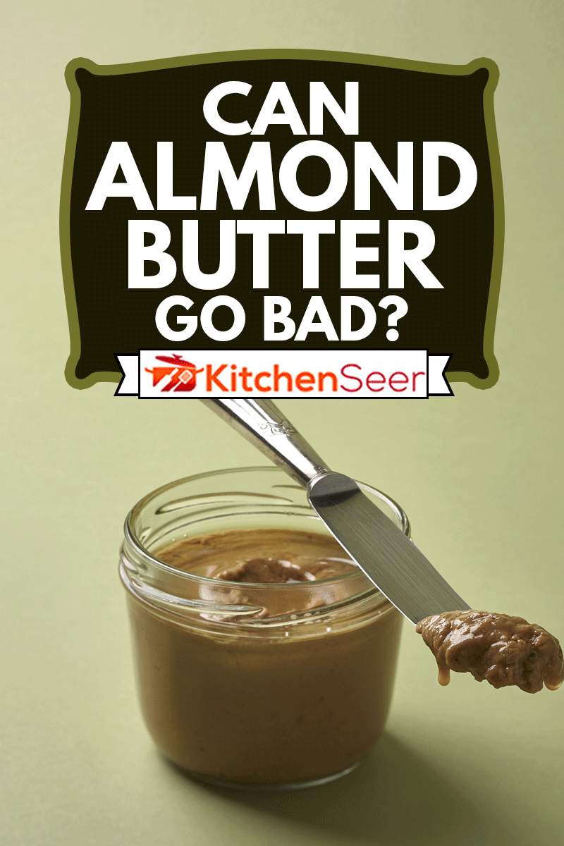 Almond butter in a jar and silver vintage knife with green background, Can Almond Butter Go Bad?