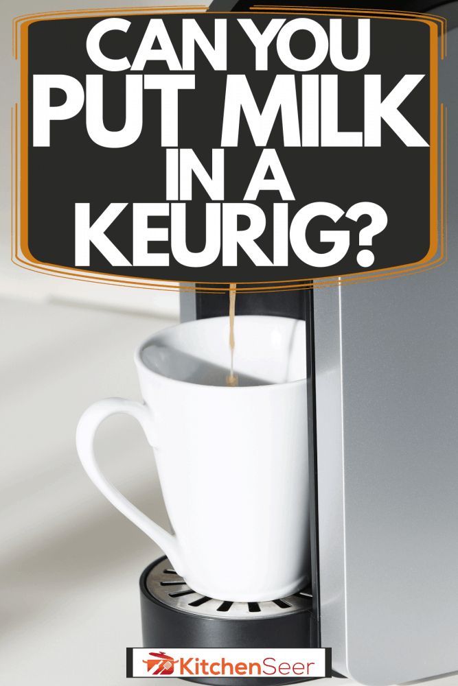 A Keurig coffee maker pouring coffee on a small cup, Can You Put Milk In A Keurig?