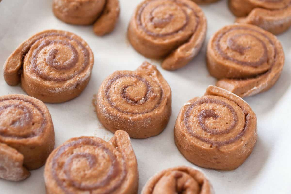 Cinnamon Rolls in wax paper, Why Didn't My Cinnamon Rolls Rise [And How To Fix It]