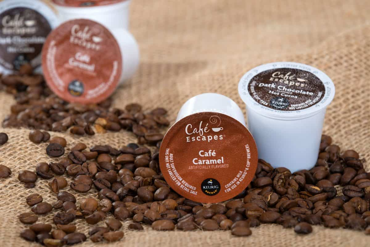Coffee beans and coffee pods placed on top of the coffee beans