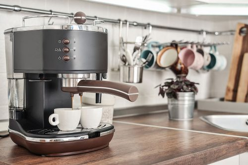 Coffeemaker with two cups in interior of modern kitchen closeup, How Hot Does Water In A Coffee Machine Get?