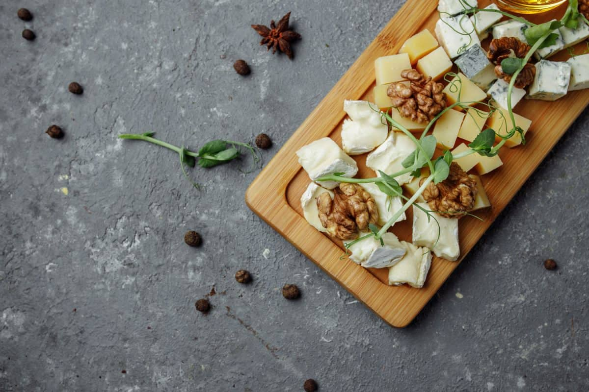 Different types of cheese placed on a cheese board, Can You Make A Cheese Board Ahead Of Time?