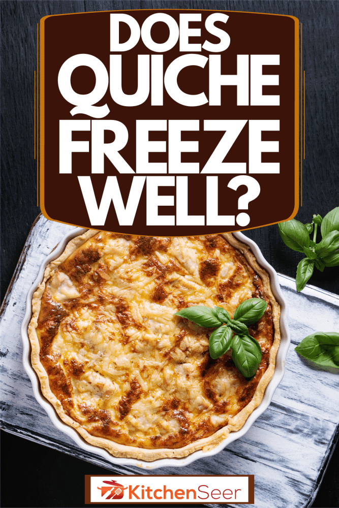 Freshly baked quiche pie with greens on top of a black table, Does Quiche Freeze Well?