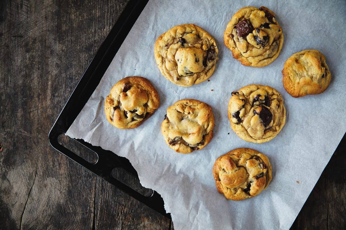 Freshly baked cookies placed under a black cookie sheet, Is A Cookie Sheet Non-Stick?