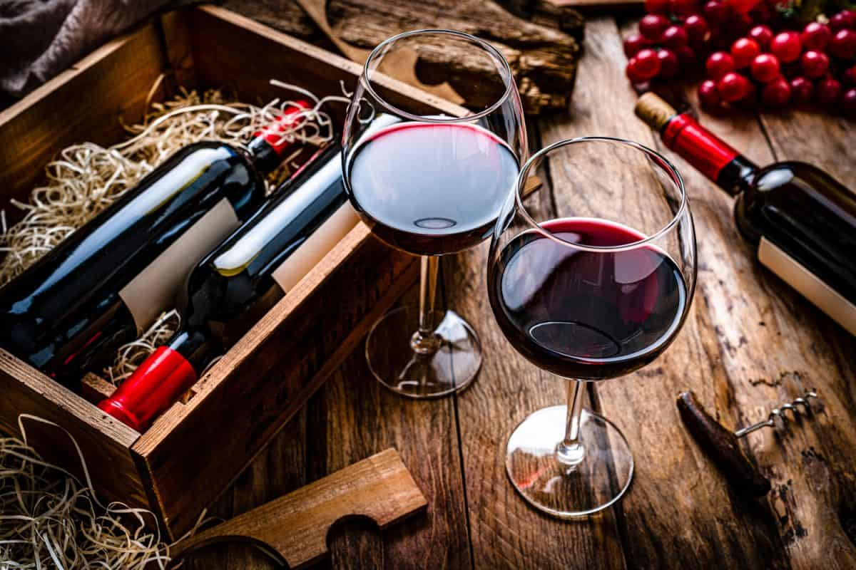 High angle view of two red wineglasses shot on rustic wooden table, Are Expensive Wine Glasses Worth The Investment?