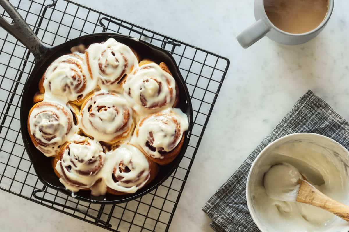 Homemade cinnamon rolls or buns baked in a cast iron skillet and covered with cream cheese icing, What Flour To Use For Cinnamon Rolls?