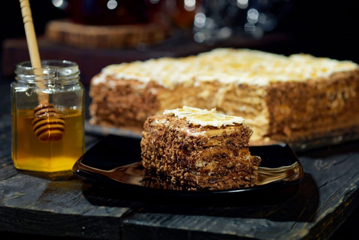 Homemade honey cake with almond butter on the table