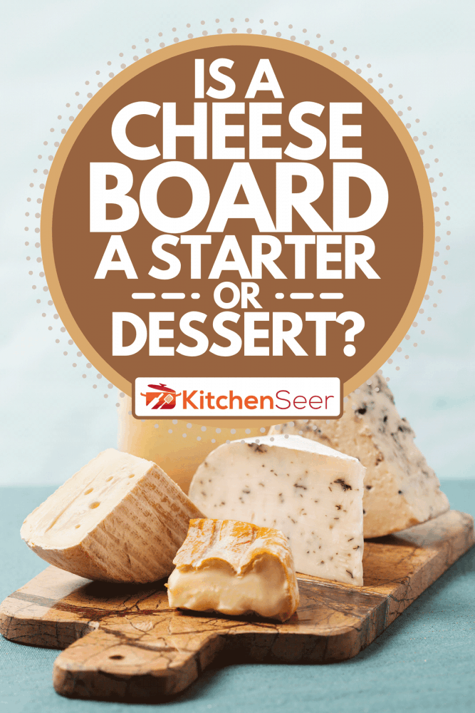 A variety of cheeses on marble serving board, Is A Cheese Board A Starter Or Dessert?