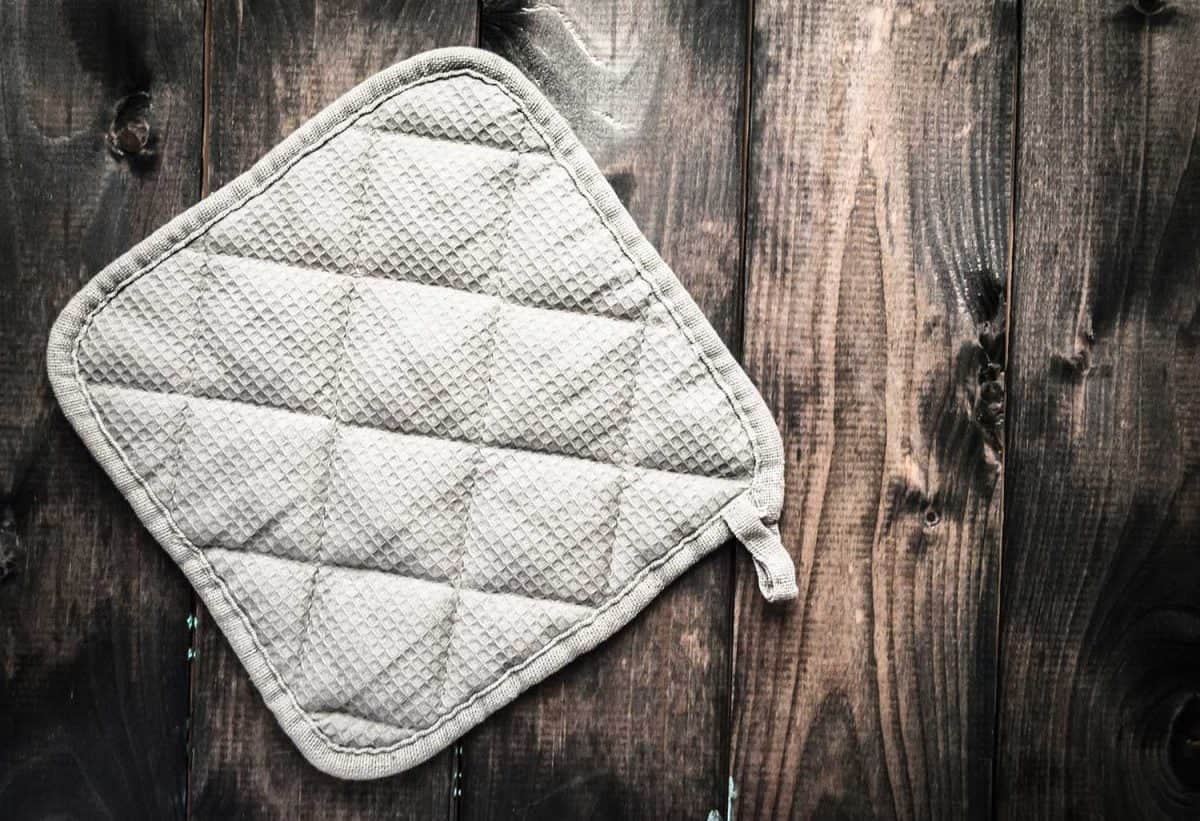 Potholder on a brown rustic wooden background