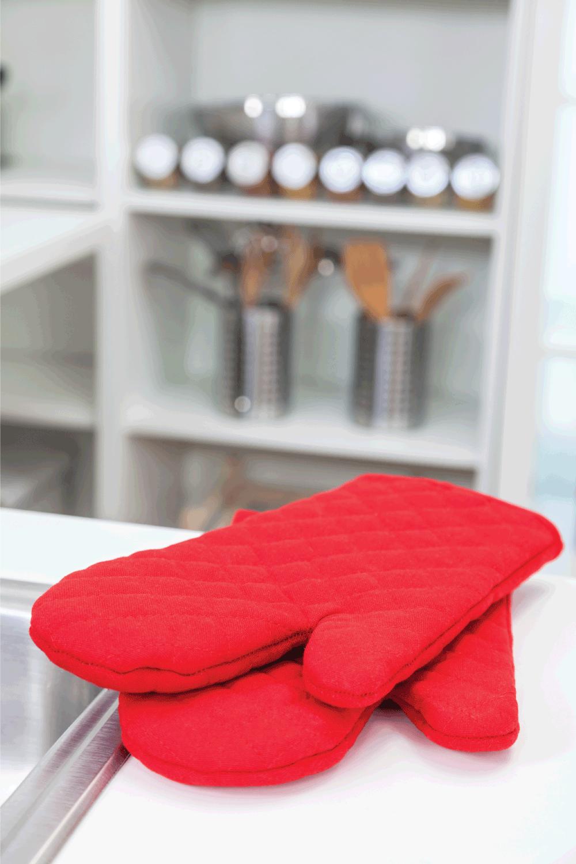 Red Oven Gloves Mittens in a Modern Kitchen