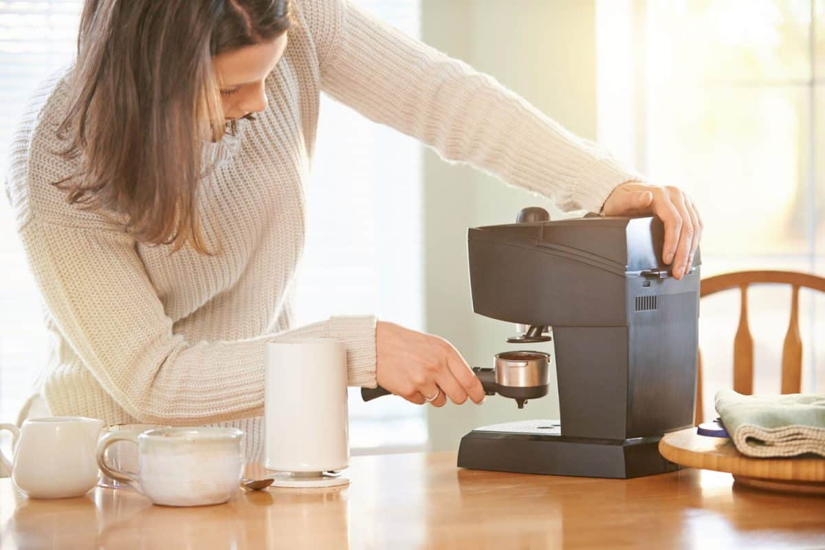 Shot of a woman making coffee at home, Can A Coffee Maker Be Used To Make Tea?