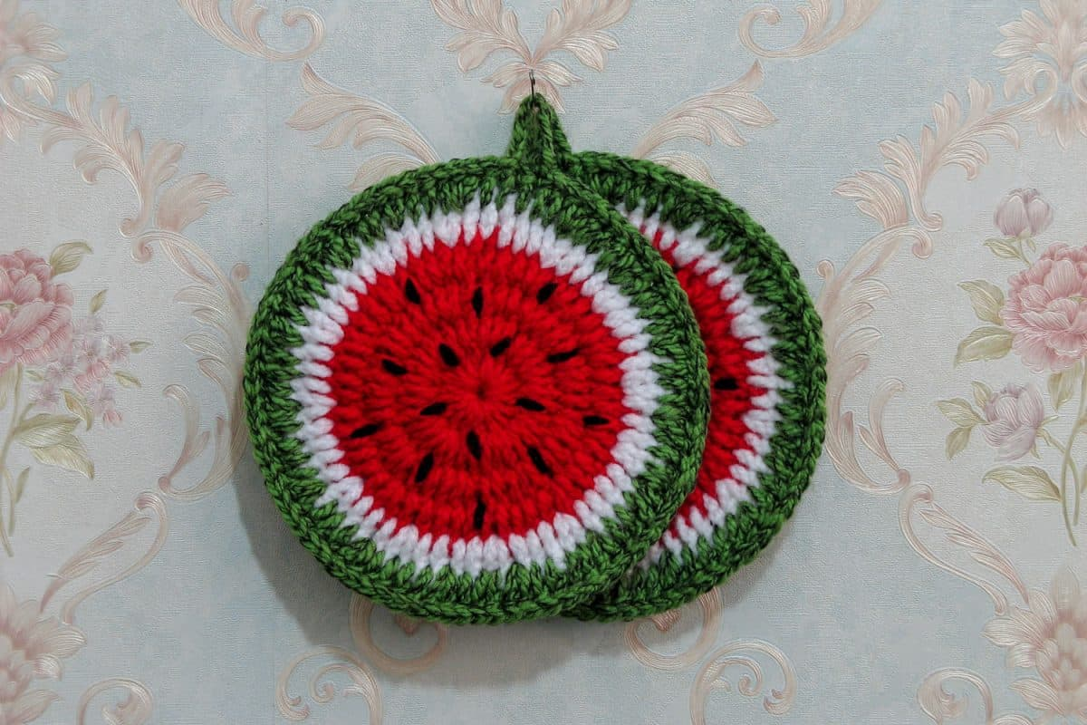 Two watermelon designed pot holder hanged on the kitchen wall, Do You Need Pot Holders On Granite?