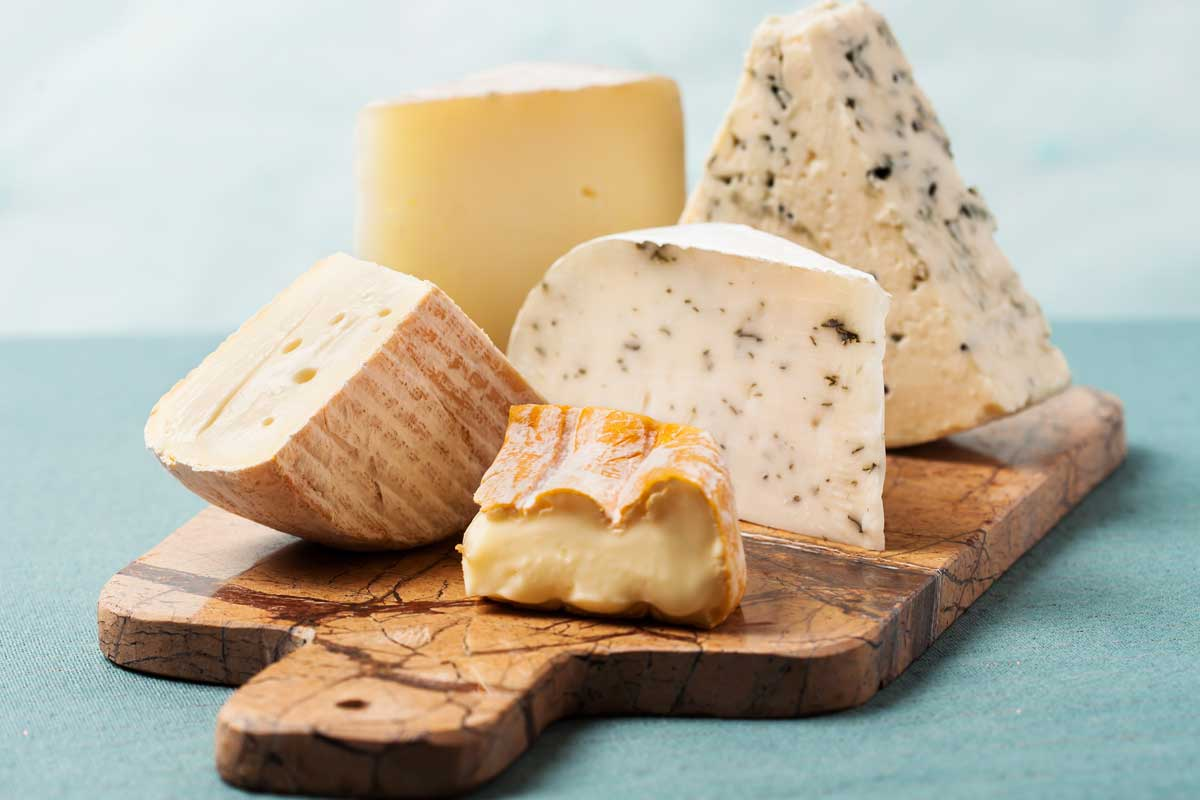 Variety of cheeses on marble serving board, Is A Cheese Board A Starter Or Dessert?