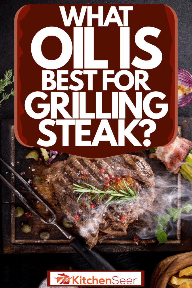 A deliciously roasted beef steak with oregano, asparagus, and small tomatoes on the side, What Oil Is Best For Grilling Steak?
