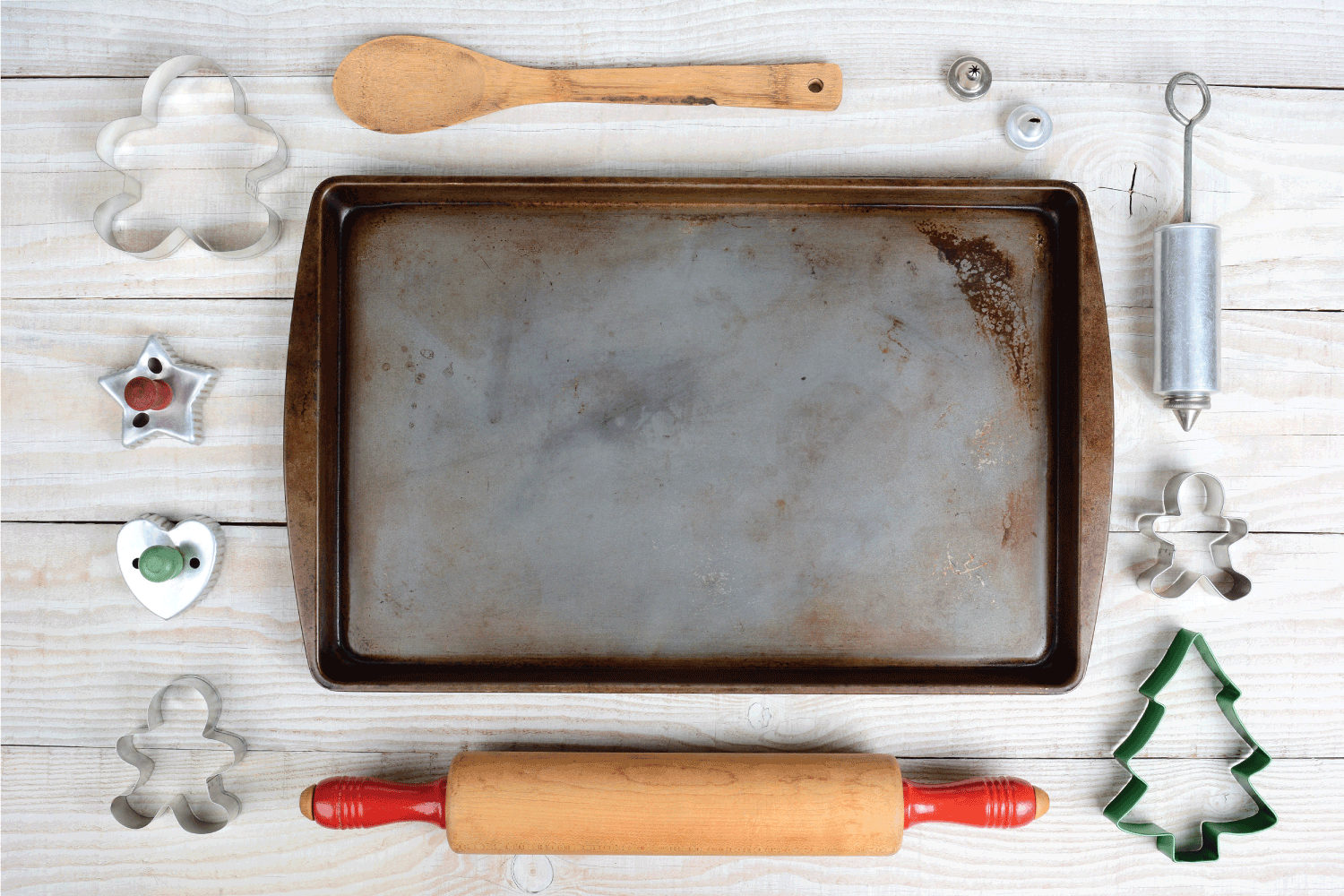 bird's eye view of baking materials, stained cookie sheet