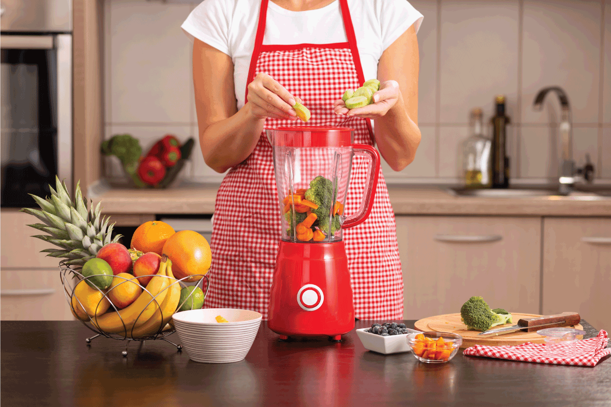 female hands putting fresh cucumbers into a blender bowl for making a vegetable broth, What Are The Parts Of A Blender