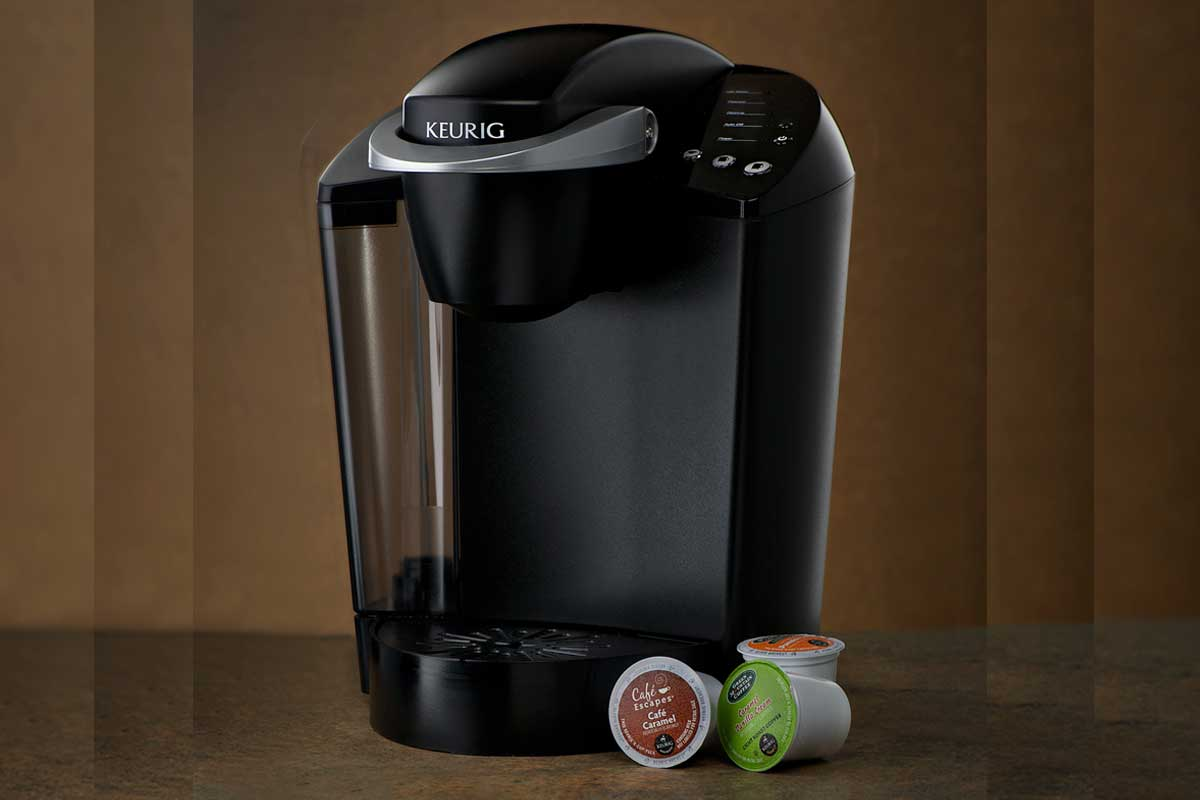 A Keurig k-cup coffee maker with three k-cup pods, Keurig Tastes Watered Down - What To Do?