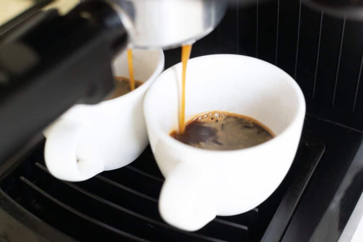 A coffee maker pouring delicious fresh coffee