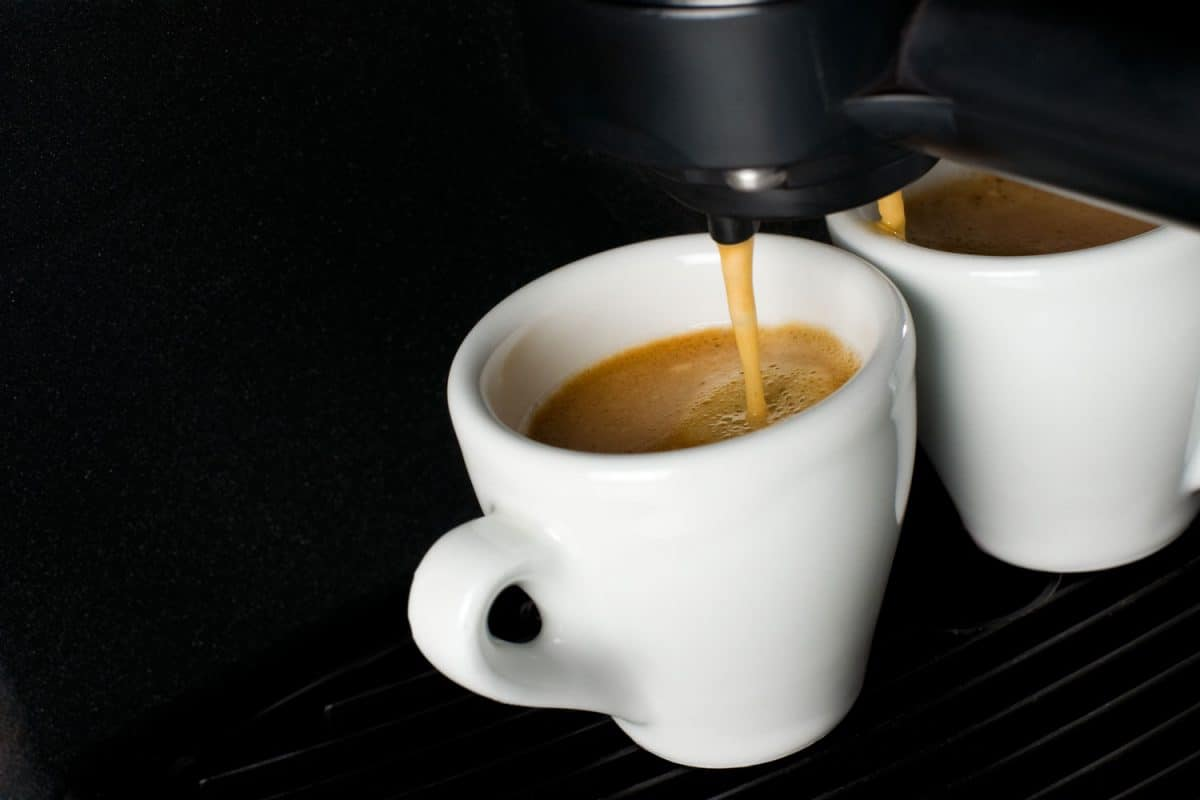 A coffee maker pouring two cups of freshly brewed coffee, How Long Does A Keurig Take To Heat Up?