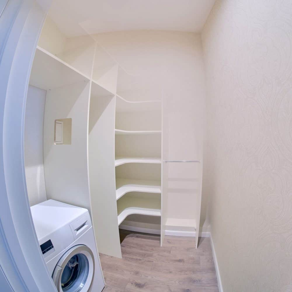 A fisheye photographed pantry and laundry room