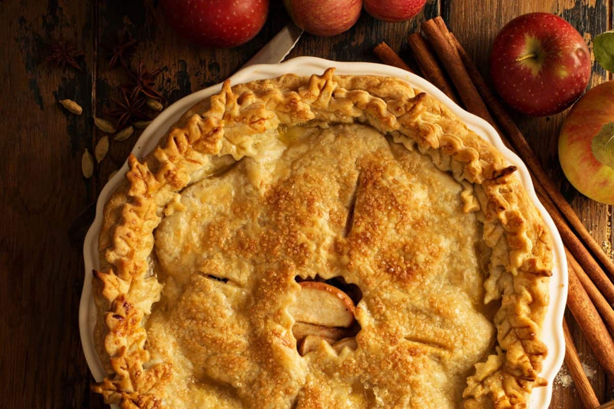 Apple pie decorated with fall leaves overhead shot, fall baking concept, Is Apple Pie Okay Left Out Overnight? [Best Storage Tips]