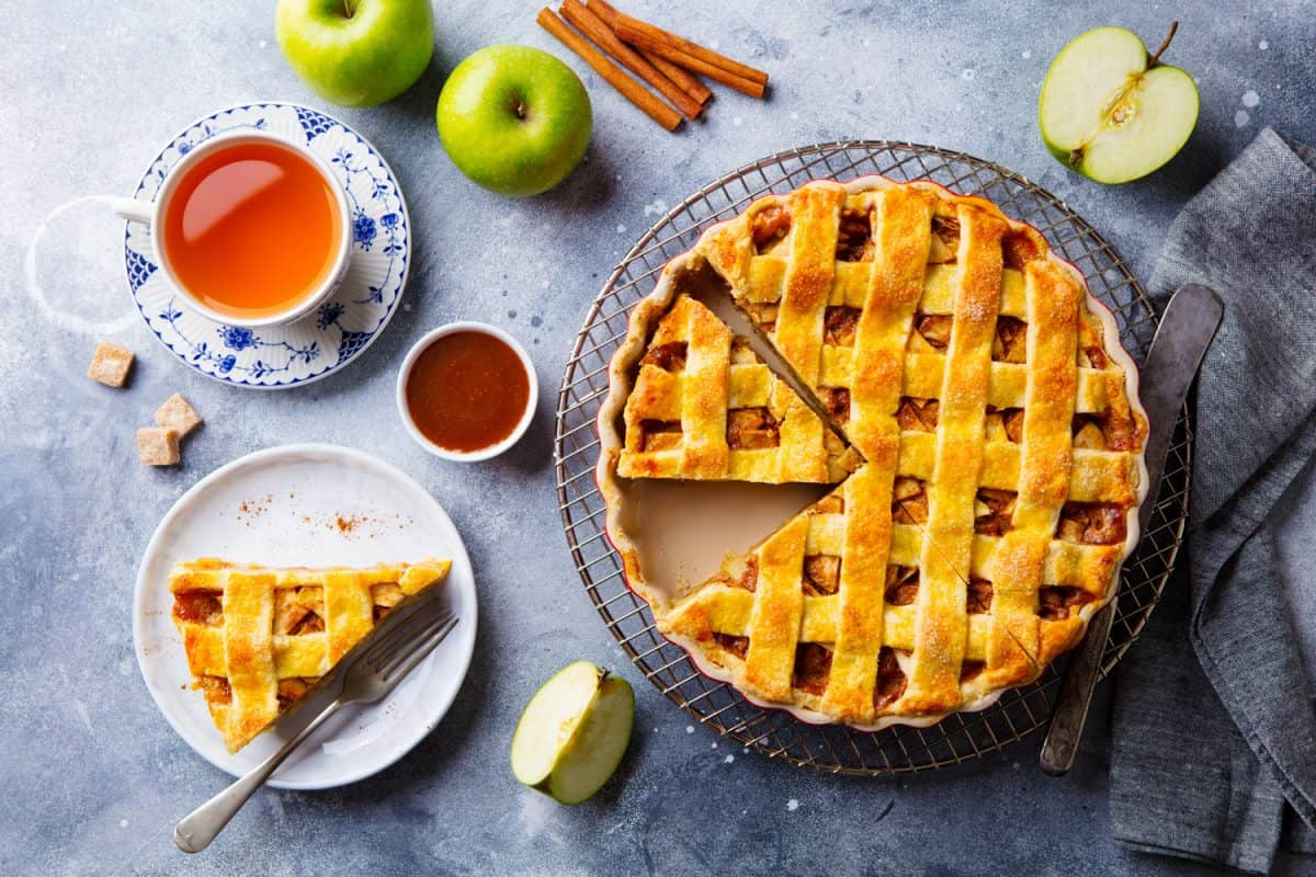 Apple pie on a cooling rack. Grey background. Can You Bake Apple Pie In A Cake Pan?