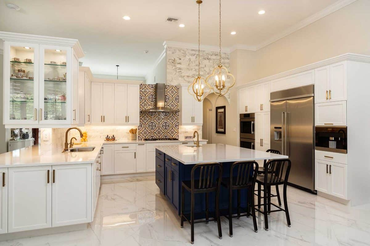 Beautiful luxury estate home kitchen with white cabinets