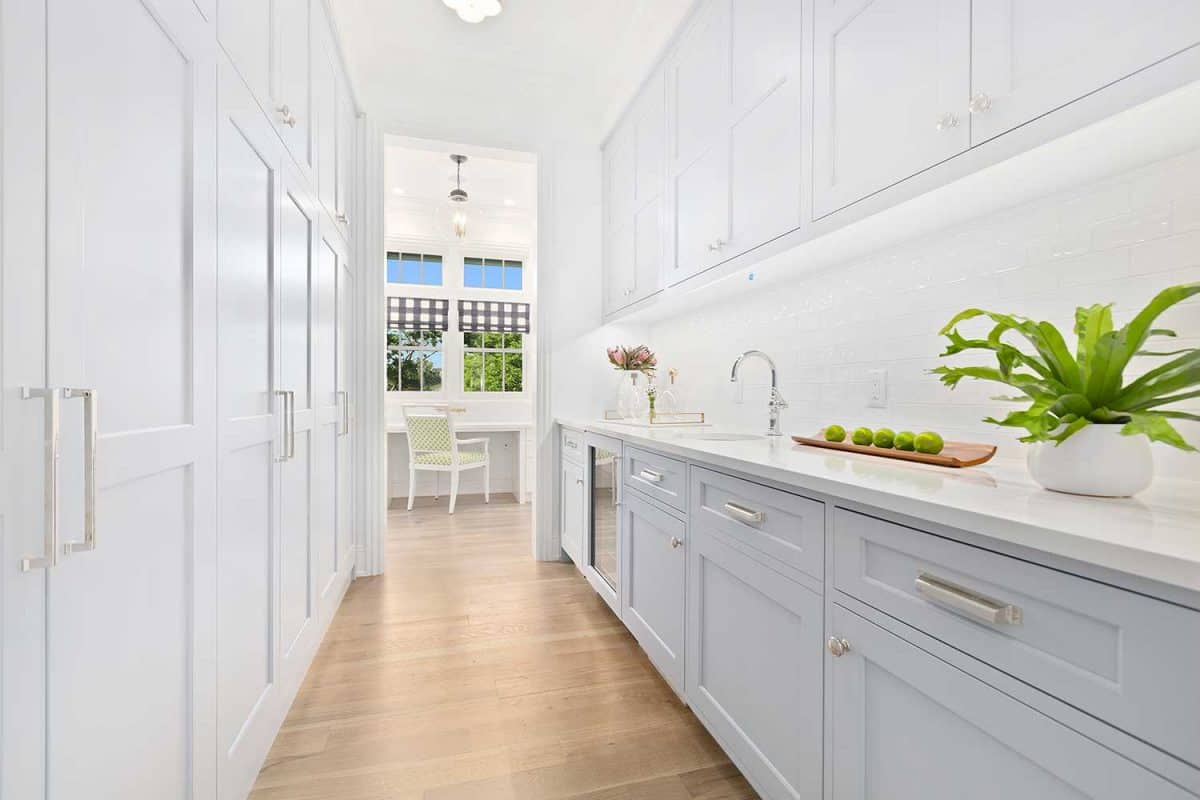 Butler pantry with white cabinetry