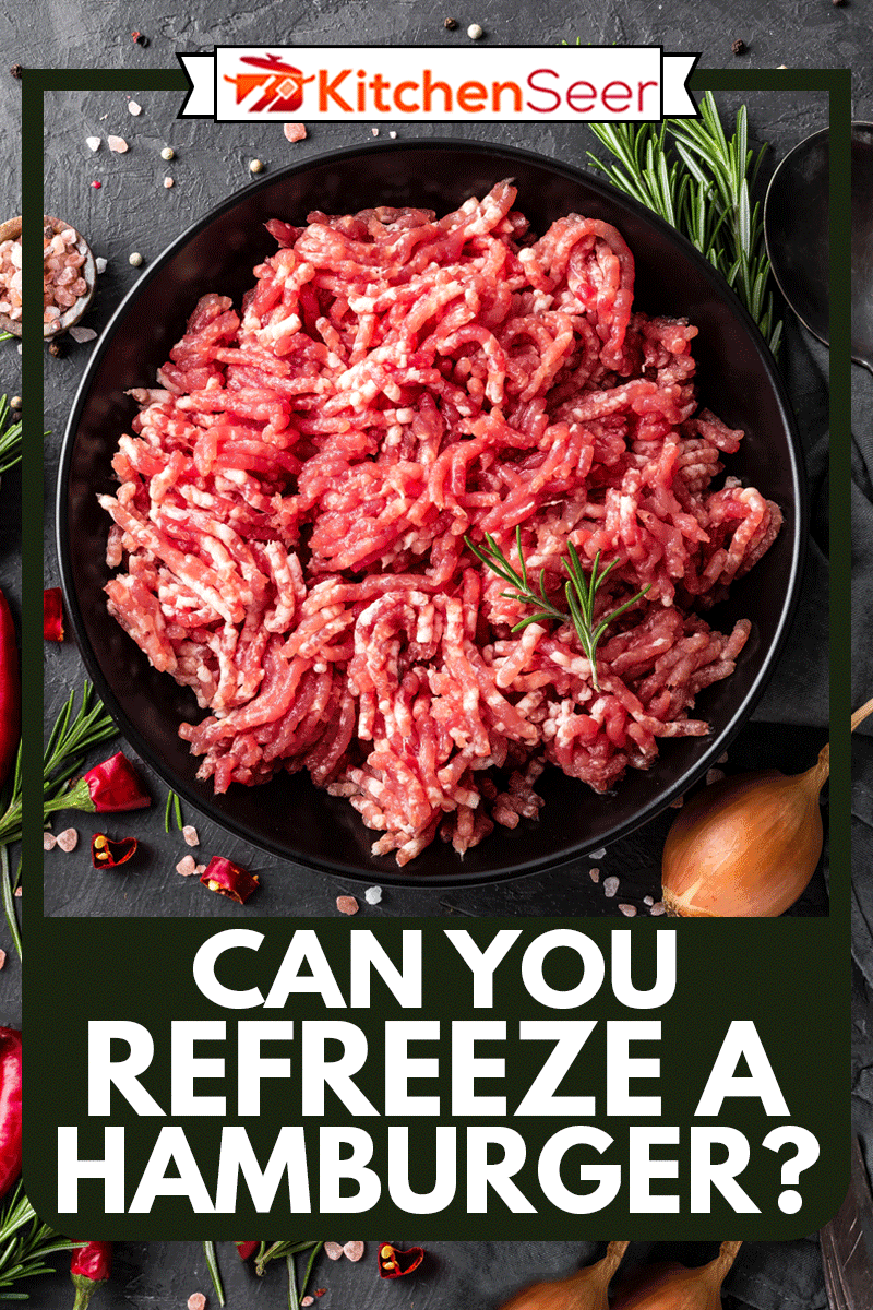 Mince. Ground meat with ingredients for cooking on black background, Can You Refreeze A Hamburger?