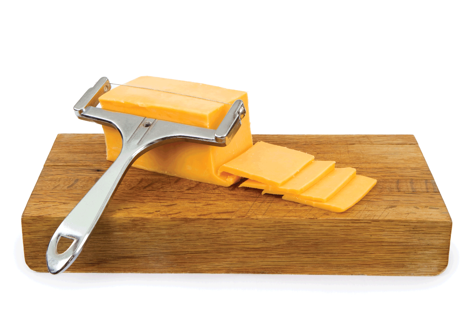 Cheddar Cheese on a Cutting Board with cheese wire cutter