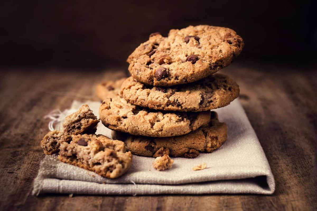 Chocolate cookies on white linen napkin on wooden table
