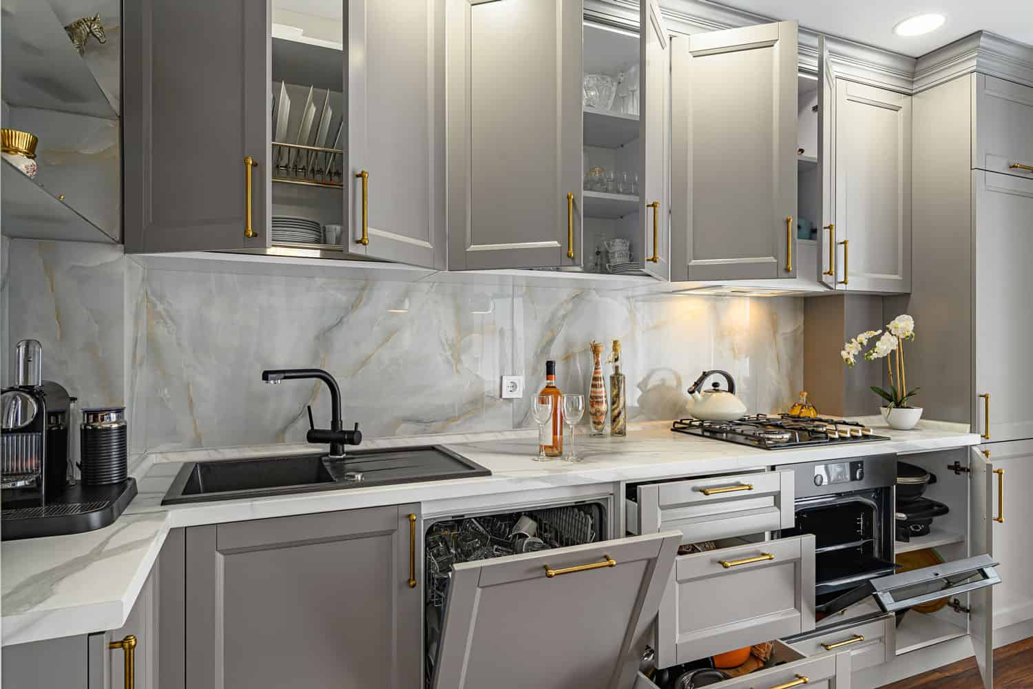 Closeup details of grey and white contemporary classic kitchen designed in modern style, all furniture doors and drawers are open, How To Make Kitchen Drawers Slide Easier