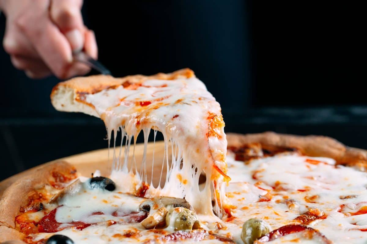 Delicious pizza with melted cheese