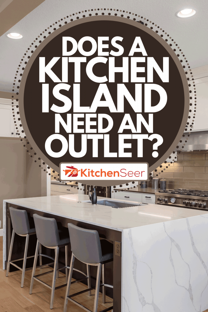 A beautiful kitchen in new home with island, pendant lights, and hardwood floors, Does A Kitchen Island Need An Outlet?