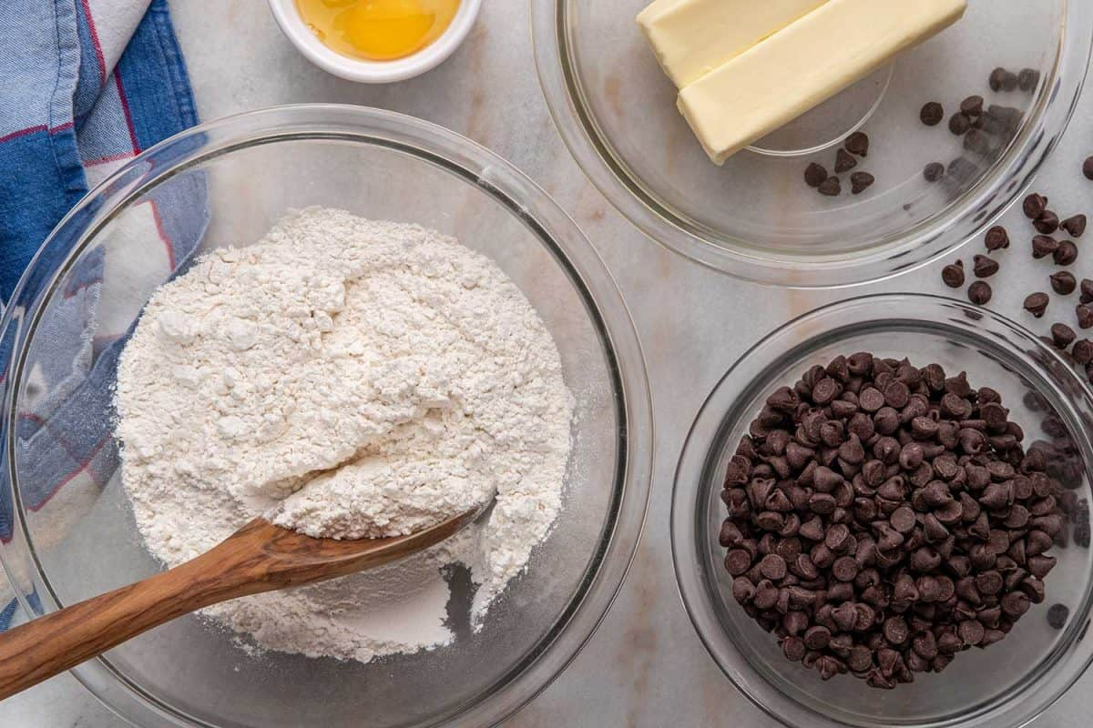 Eggs, butter, flour and chocolate chips for chocolate chip cookie batter