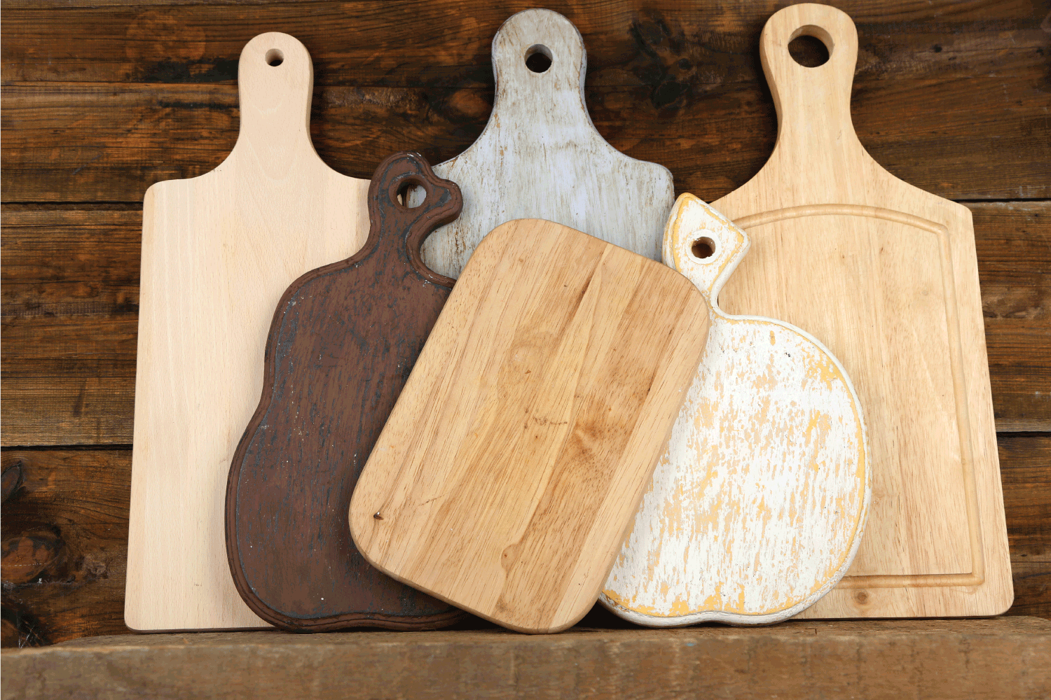 Empty cutting boards on wooden background. How Many Cutting Boards Do I Need