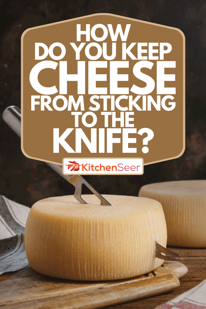 A fresh homemade cheese on a wooden board with a knife, How Do You Keep Cheese From Sticking To The Knife?