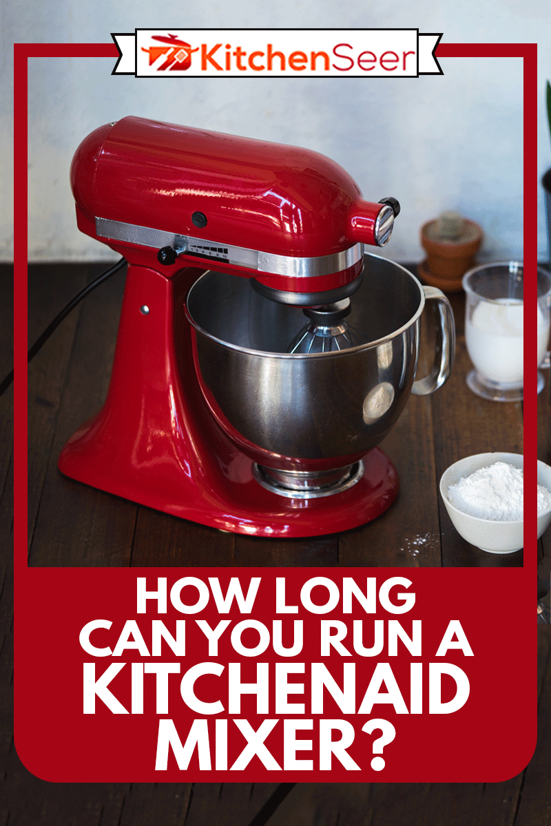 Closed standing kitchenaid mixer on wooden table with ingredients, How Long Can You Run A Kitchenaid Mixer?
