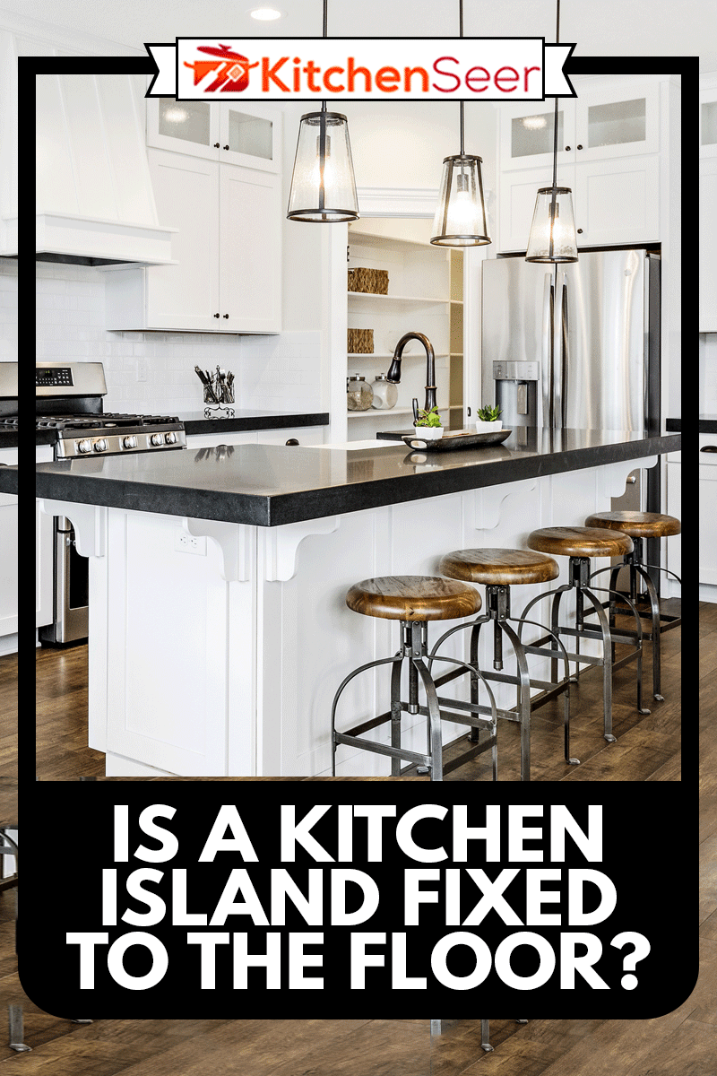 White gourmet kitchen with black countertops, Is A Kitchen Island Fixed To The Floor?
