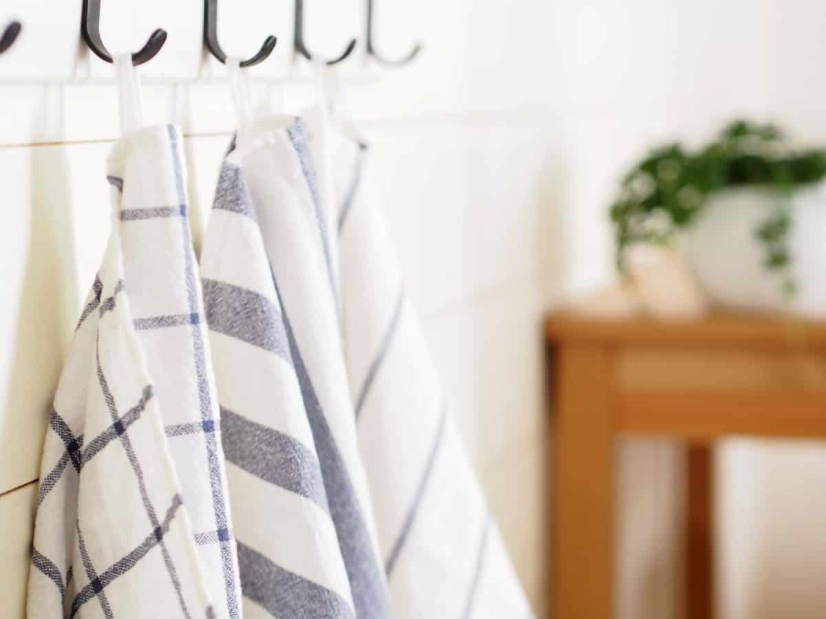 Kitchen towels hanging on hooks
