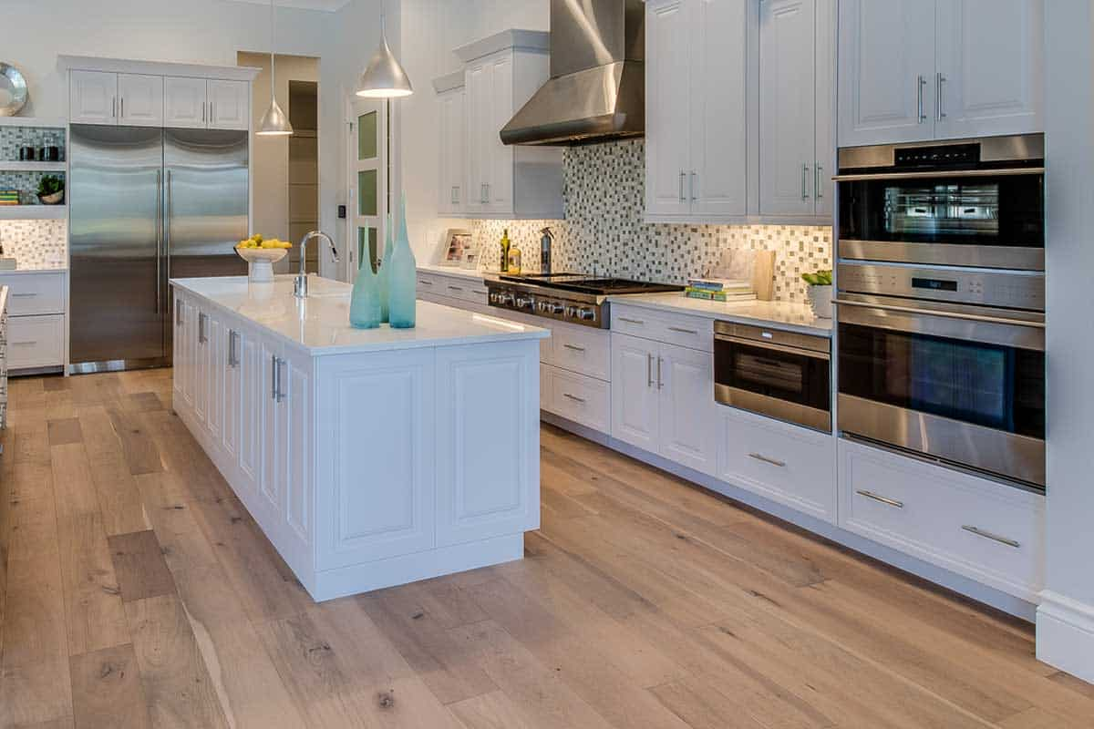 Large spacious kitchen with stainless steel appliances, Should The Kitchen Floor Match The Rest Of The House?