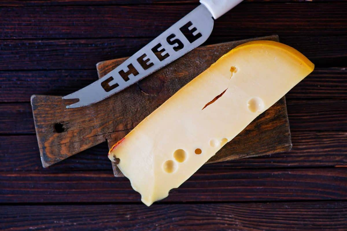 Piece of cheese with knife